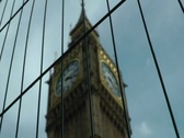 Stock Video Footage of Big Ben clock tower behind fence london