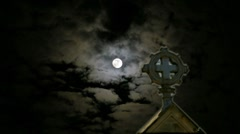 Spooky Dramatic Gothic Glowing Church Cross Full Moon Scary Clouds Stock Footage