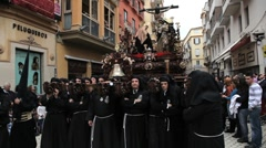 Costaleros bearing a Trono in a procession, Semana Santa, Malaga, Spain - stock footage