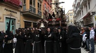 Stock Video Footage of Costaleros bearing a Trono in a procession, Semana Santa, Malaga, Spain