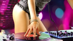 Super sexy female dj playing Stock Footage