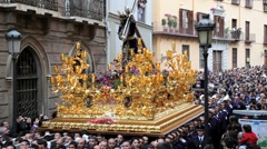 Costaleros bearing a Trono a religious float during Semana Santa, Malaga, Spain Stock Footage