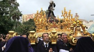 Stock Video Footage of Golden Trono a religious float being carried by the Costaleros, Malaga, Spain