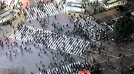 Stock Video Footage of Japan, Tokyo, Shibuya, commuters walking over the famous Shibuya Crossing