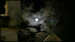 Stock Video Footage of Spooky Dramatic Gothic Church Cross Tower Full Moon Scary Clouds