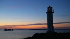 Lighthouse and ship by sunset Stock Footage