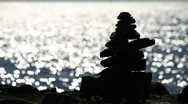 Cairn and glittering water Stock Footage