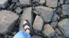 Walking on rocks Stock Footage