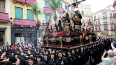 Stock Video Footage of Costaleros bearing a Trono a religious float, Semana Santa, Malaga, Spain