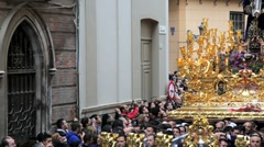 Stock Video Footage of People watch the Costaleros bearing a Golden Trono, Malaga, Andalucia, Spain