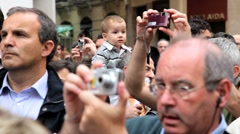 People photographing the procession in Holy week, Semana Santa, Malaga, Spain Stock Footage