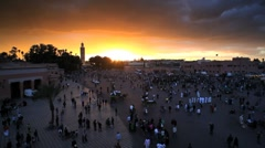 Djemaa el-Fna and the Koutoubia Mosque, Marrakech, Morocco, North Africa, Africa Stock Footage