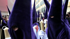 Stock Video Footage of Nazarenos parade during the celebration of Semana Santa, Malaga Spain
