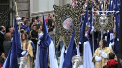 Stock Video Footage of People watching the Hooded Nazarenos parade, Malaga Spain