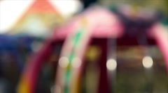 Carousel spinning in city park, blurred. Stock Footage