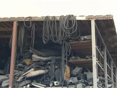 Door rubber and other parts of car loaded to the high shelves. - stock footage