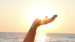 Sun in hand - stock footage
