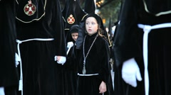 Stock Video Footage of Young girl with Hooded Nazarenos, Semana Santa a Holy week in Malaga Spain
