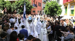 Stock Video Footage of People watching the Hooded Nazarenos parade, Semana Santa, Malaga Spain