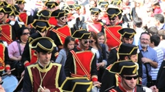 Stock Video Footage of Parade of Bandsmen in a procession in Malaga in Semana Santa, Holy week, Spain