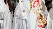 Stock Video Footage of The white hooded Nazarenos parade, Semana Santa, Malaga Spain