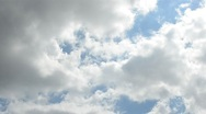 Stock Video Footage of Blue sky with clouds and sun.