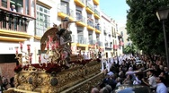 Stock Video Footage of Costaleros bearing a Trono a religious float, through the streets of Malaga