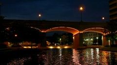 Worlds fair park lake and illuminated bridge seen at night Stock Footage