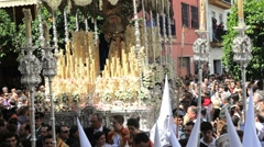 Stock Video Footage of Costaleros bearing a Trono a religious float during Semana Santa, Malaga, Spain