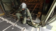 Stock Video Footage of Airman getting ready for package drop (HD) c