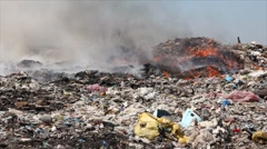 Burning garbage dump, ecological pollution - stock footage