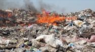 Burning garbage dump, pollution Stock Footage