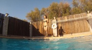 Stock Video Footage of Asian woman having fun in a pool in the summer - sporty - 1
