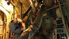 Airman checking equipment on C-130 (HD) c Stock Footage
