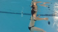 Stock Video Footage of Asian woman having fun in a pool in the summer - sporty - under water - 4