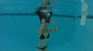 Stock Video Footage of Asian woman having fun in a pool in the summer - sporty - under water - 3