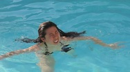 Stock Video Footage of Asian woman having fun in a pool in the summer - sporty - 14