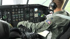 Pilot in cockpit of C-130 (HD) c - stock footage