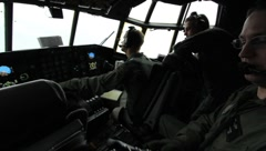 Pilots in cockpit of C-130 (HD) c Stock Footage