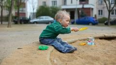 Small child playing in the sandbox Stock Footage