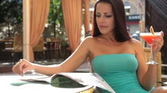 Elegant woman in cocktail dress rests in Cafe Stock Footage