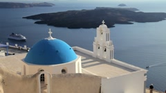 Blue Dome of the local church and the white washed houses of Thira, Greece Stock Footage