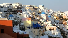 The beautiful town of Oia with people enjoying a drink at the local Cafe, Stock Footage