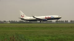Arkefly plane lands at Schiphol Stock Footage