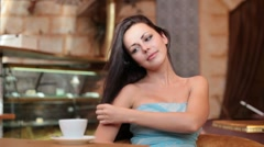 Young woman with a cup of coffee Stock Footage
