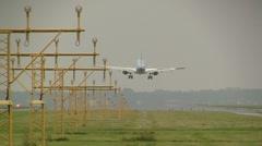 KLM plane lands on runway at Schiphol - stock footage