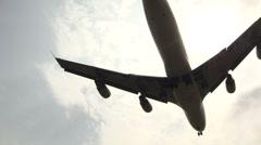 JumboJet passes low overhead Stock Footage