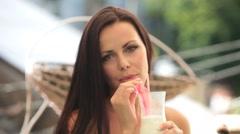 Stock Video Footage of smiling beautiful woman with milkshake