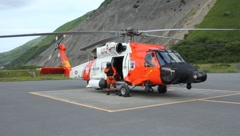 Coast Guard Helicopter and guardsman on tarmac (HD) c Stock Footage