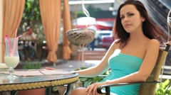 Woman in a cocktail dress at a restaurant Stock Footage